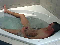 This horny young boy likes to stroke himself in a hot bath!